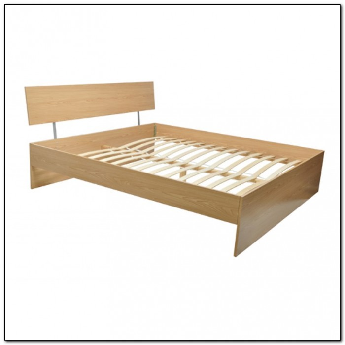 Wooden bed frames double beds home design ideas for Wood futon frame ikea