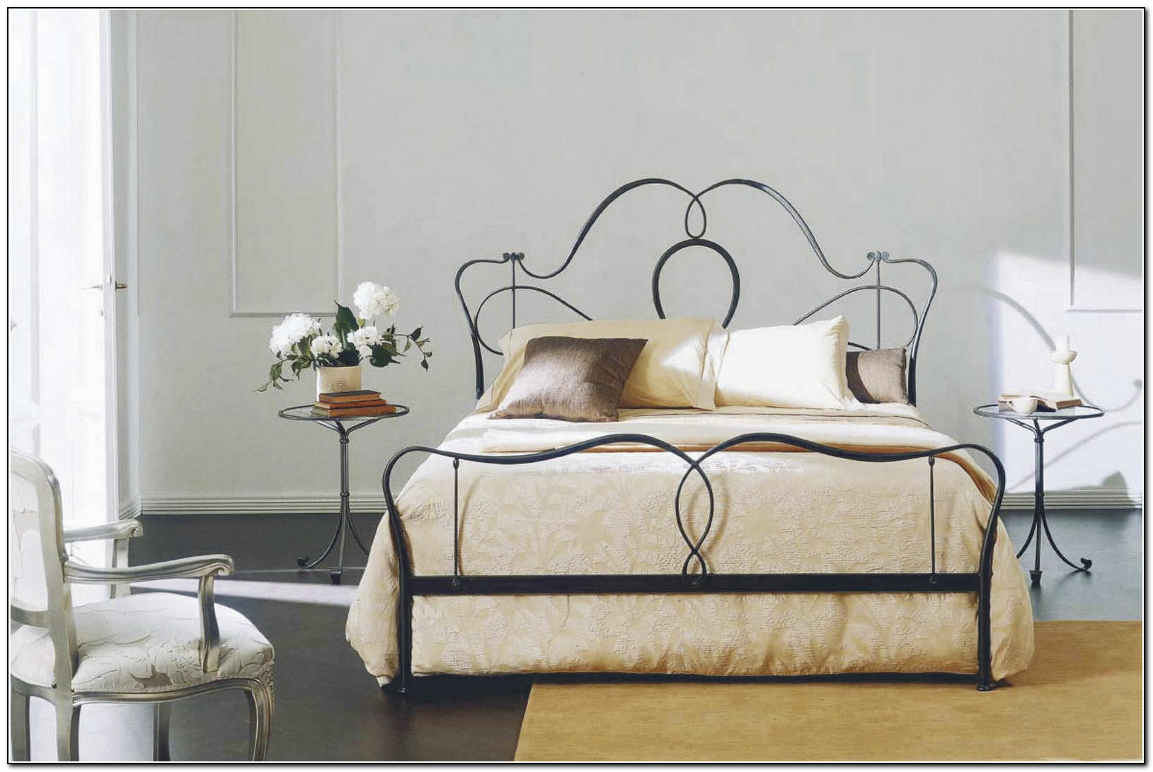 Wrought iron bed ikea beds home design ideas for Iron bed with storage