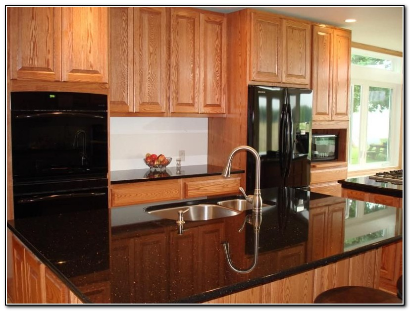 Cherry kitchen cabinets with black appliances download for Cherry kitchen cabinets with white appliances