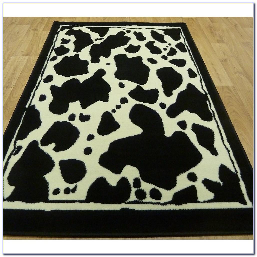 Cow print rug for nursery rugs home design ideas for Zebra rug ikea