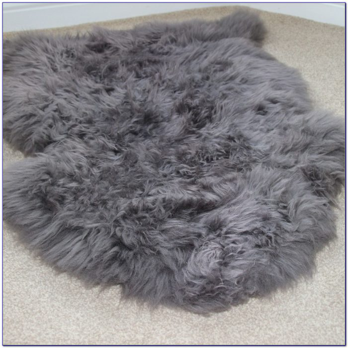 Grey sheepskin rug ikea rugs home design ideas for Lambskin rug ikea