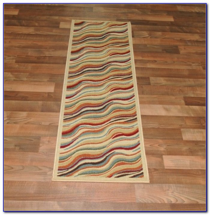 Latex backed rugs on laminate floors rugs home design for Rugs for laminate floors