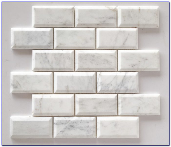 Beveled White Subway Tile With Dark Grout