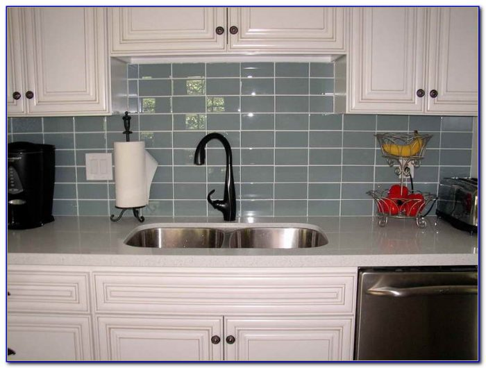 Grey Subway Tile Backsplash With Dark Cabinets