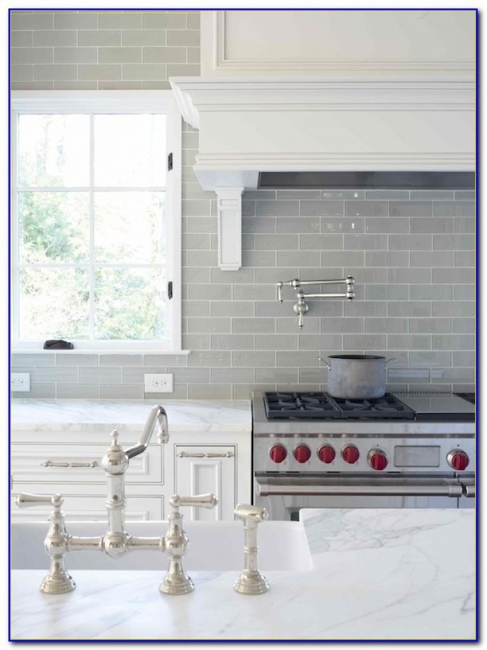 Grey Subway Tile Backsplash With White Cabinets