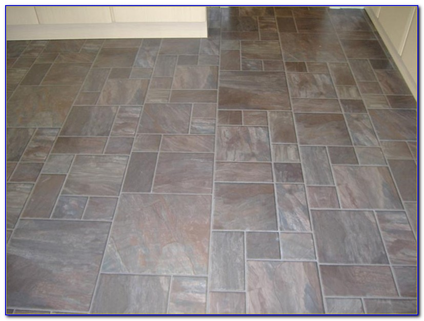 Tile effect laminate flooring grey download page home for Garden decking tiles homebase