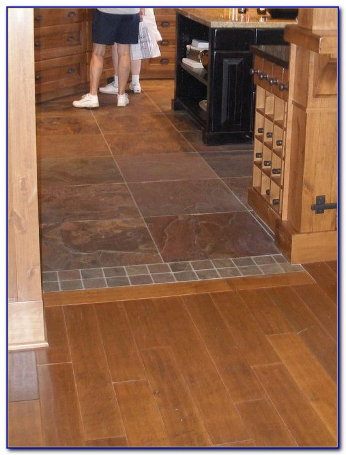 Uneven tile to wood floor transition tiles home design for Wood floor pieces