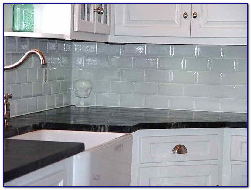 White Beveled Subway Tile Bathroom