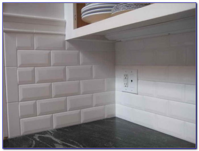 White Beveled Subway Tile Shower