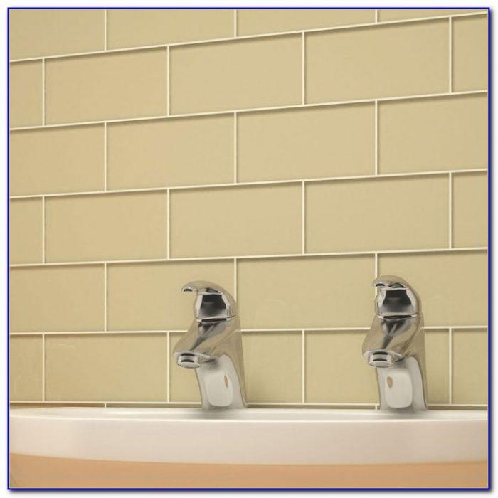 Beige Subway Tile Backsplash With White Cabinets