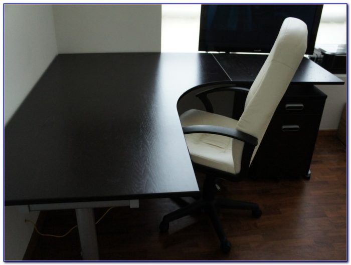 Ikea black l shaped desk desk home design ideas for Ikea desk black