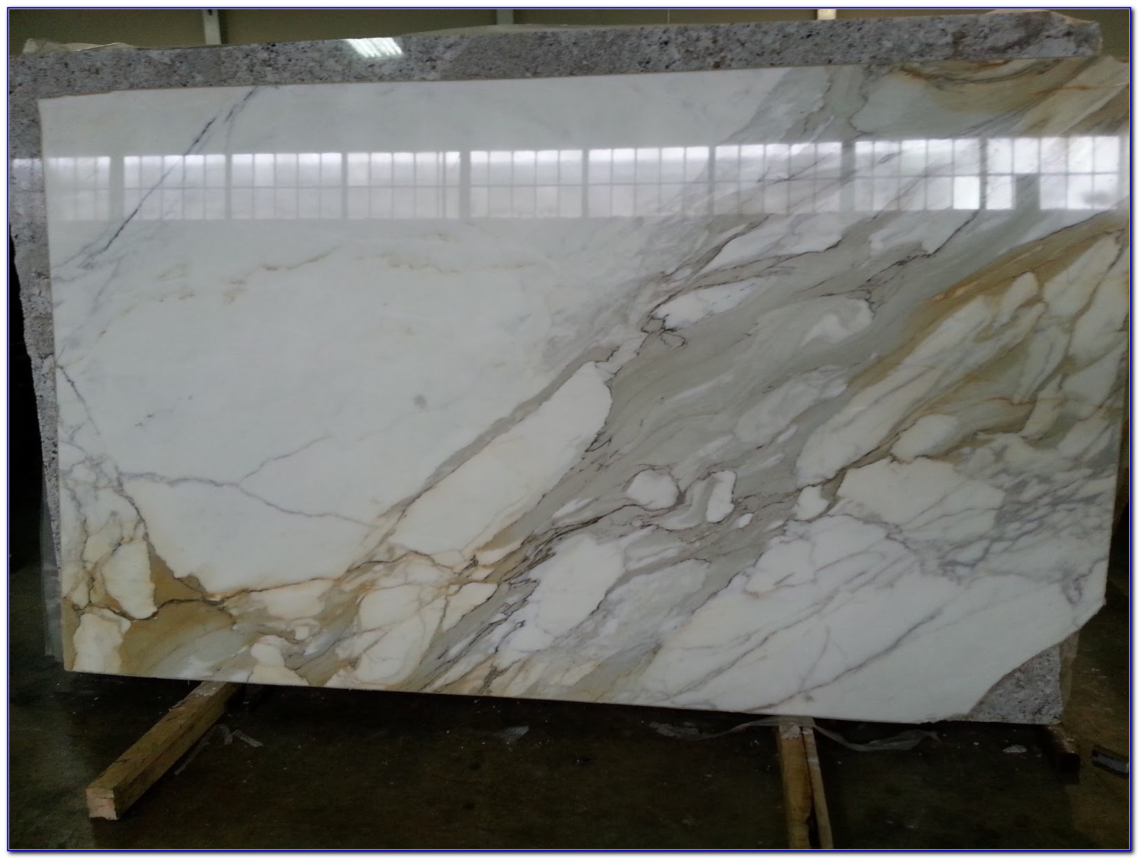 Calcutta Gold Marble Tile Backsplash
