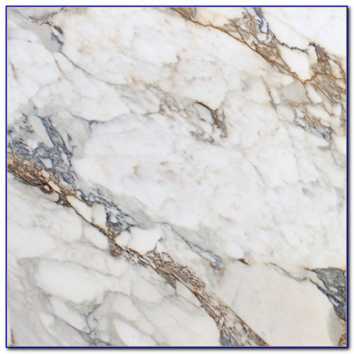 Calcutta Gold Marble Tile Herringbone