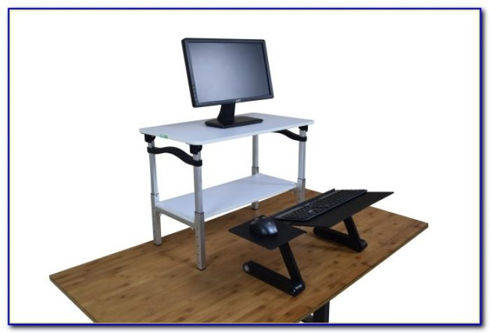 Laptop standing desk conversion desk home design ideas for Stand up desk conversion ikea