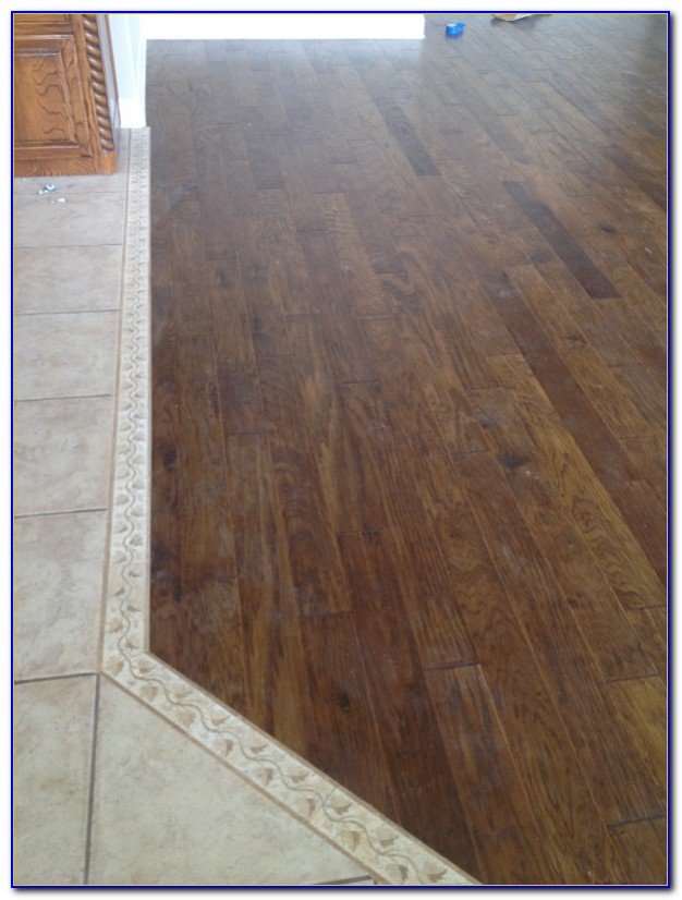 Dark Wood Floor Transition To Tile