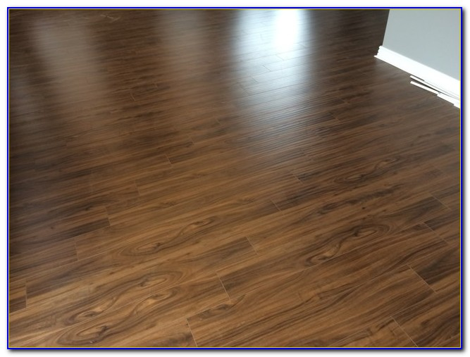 High end laminate flooring vs hardwood flooring home for Quality laminate flooring