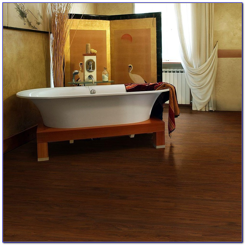 Resilient vinyl plank flooring vs laminate flooring for Vinyl laminate flooring
