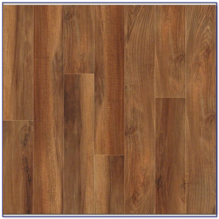Underlayment for laminate flooring over concrete for Laminate flooring over vinyl
