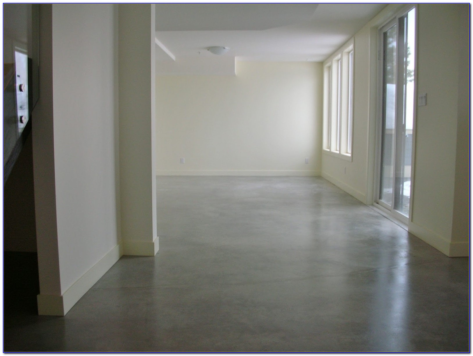 Waxing a stained concrete floor flooring home design for Best wax for stained concrete floors