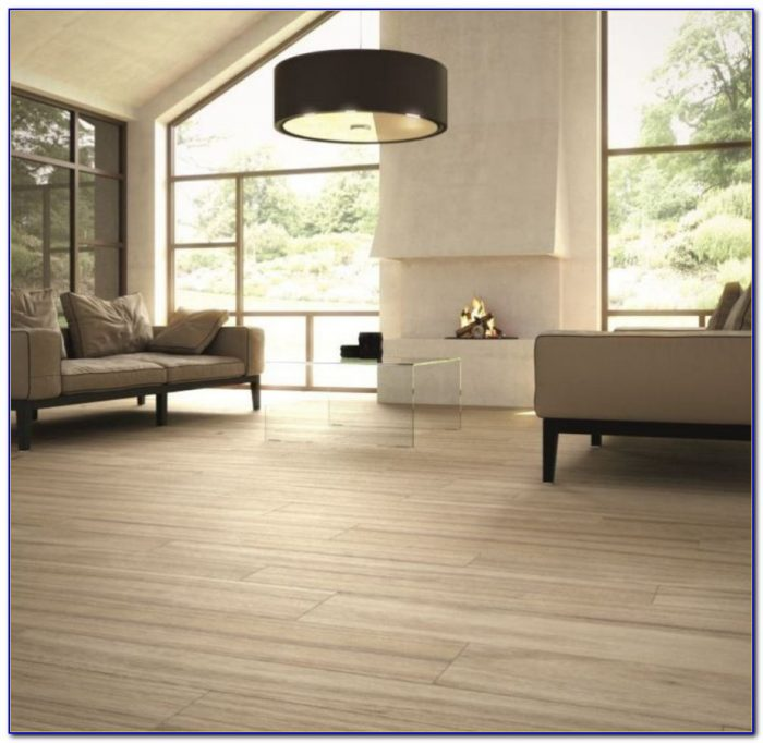 Porcelain or ceramic tile for living room flooring for Ceramic tile flooring ideas living room